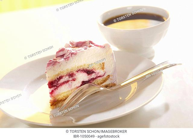 Slice of cherry cake and a bowl of coffee