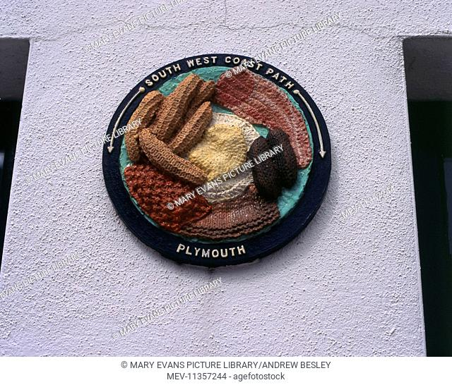 Coastal footpath plaque in Plymouth, Devon, South West Coast Path, in the style of a full English breakfast, knitted!