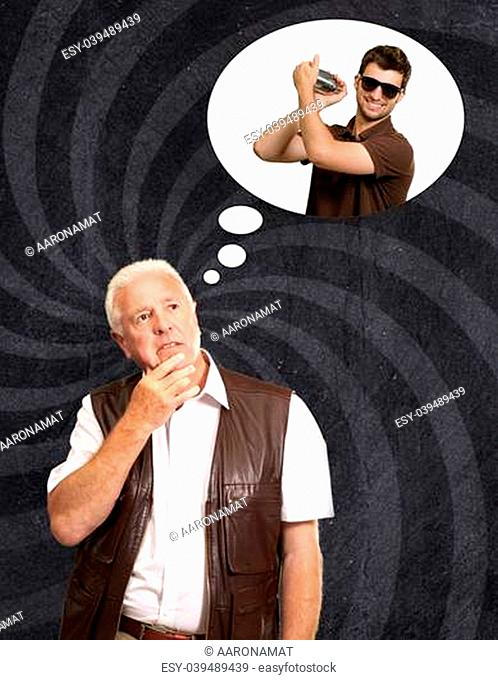 Senior Man Thinking About Man Holding Shaker On Wallpaper