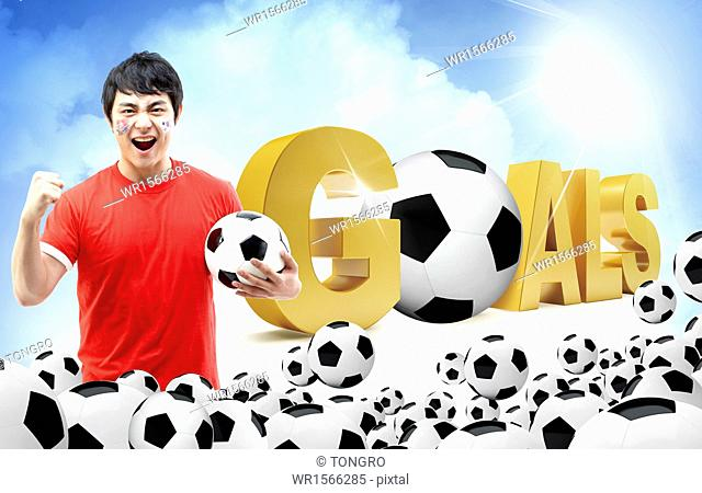 a football player standing next to the word goals