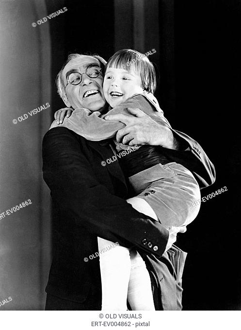 Grandfather and granddaughter hugging each other All persons depicted are not longer living and no estate exists Supplier warranties that there will be no model...