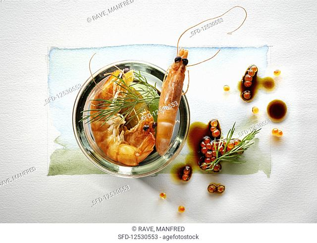 Food art: prawns with caviar, soy sauce and dill on a page of watercolour