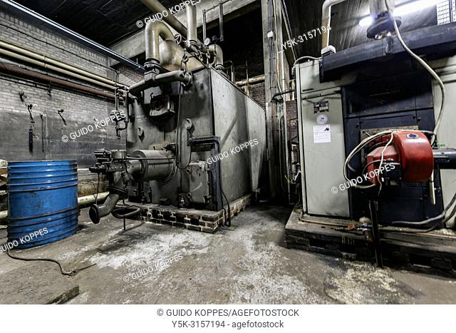 Rotterdam, Netherlands. Ancient, Historical and Out Dated central heating unit inside the cellar of an abandoned Fruit Wharf harbour Terminal