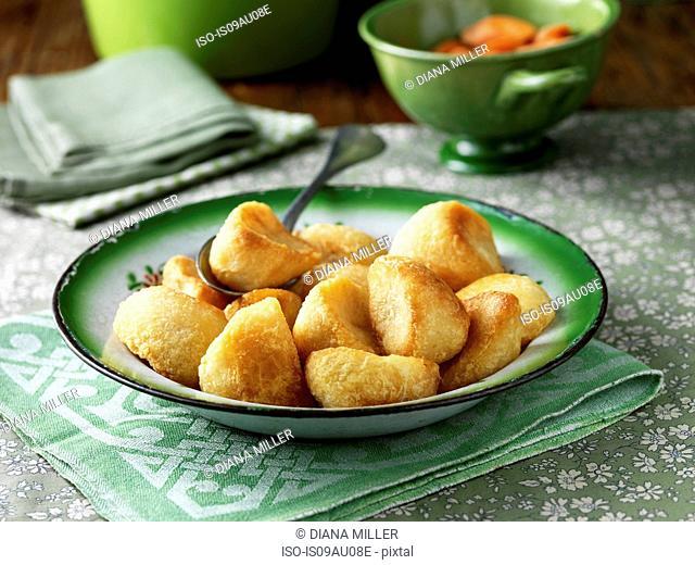 Roast potatoes in green vintage bowl
