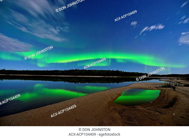 Aurora borelais (Northern Lights) over Pine Lake in moonlight, Wood Buffalo Ntional Park, Alberta, Canada