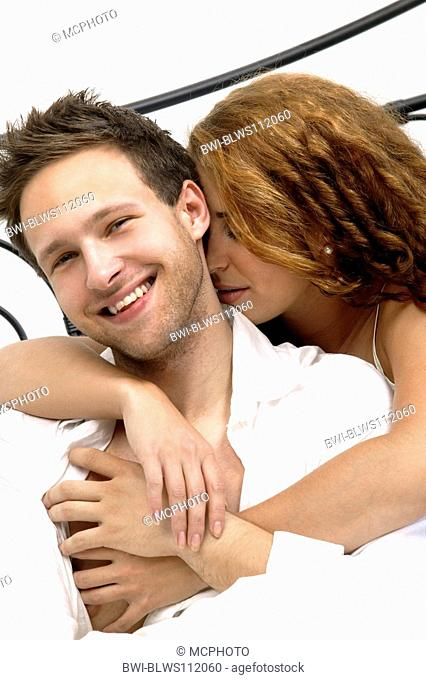 young couple in love in bed