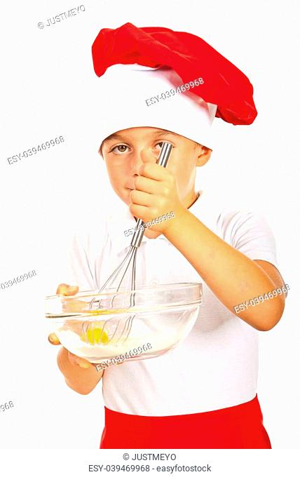 Boy chef mixing egg with floor isolated on white background