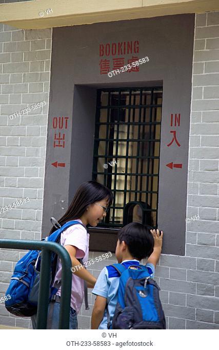 A mother showing her son the booking window, Hong Kong Railway Museum, Taipo, Hong Kong