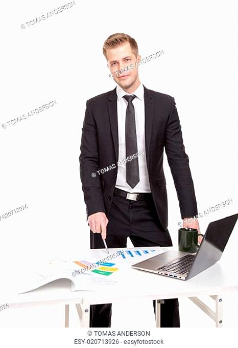 Businessman standing behind the office desk