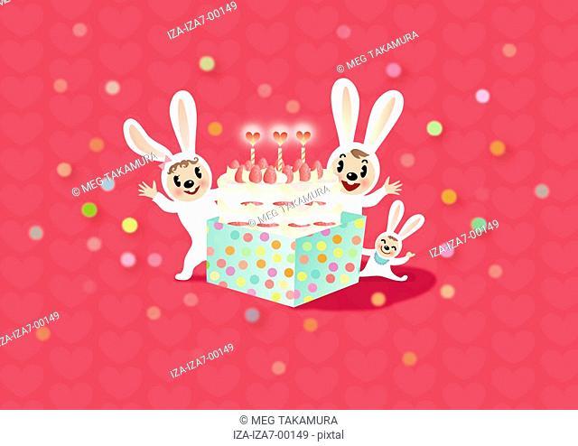 Three rabbits celebrating a birthday
