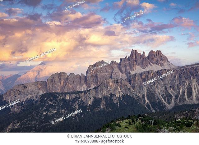 Colorful evening clouds over Croda da Lago & Lastoni di Formin mountain ranges, Dolomite Mountains, Belluno, Italy