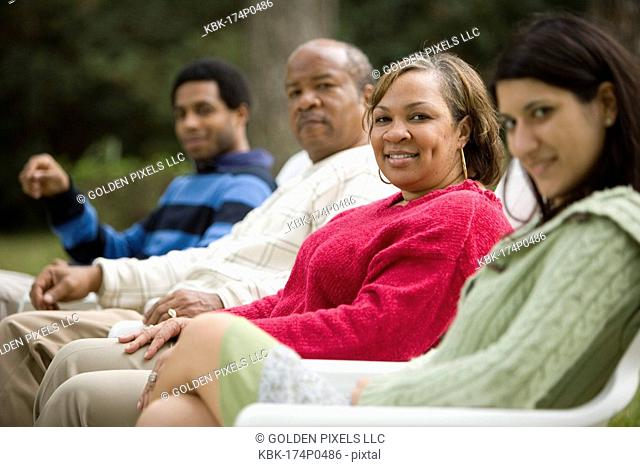 Mature woman smiling with family in background