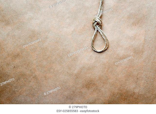 concept hangman's knot on kraft paper backgroun close up
