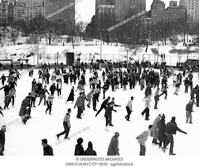 New York, New York: c. 1952 Ice skaters throng to the Park for skating fun on a winter's day in Manhattan's Central Park