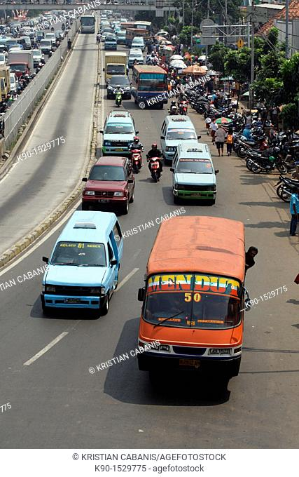 View from above with traffic jam on Jalan Matraman with mini busses, Jakarta, Java, Indonesia, Southeast Asia