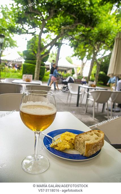 Glass of beer and Spanish omelet serving in a terrace. Spain