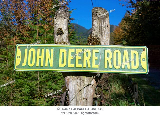 John Deere Road sign on a post