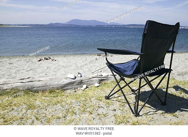 Foldable chair on the beach at Sidney Spit Marine Park, BC, Canada