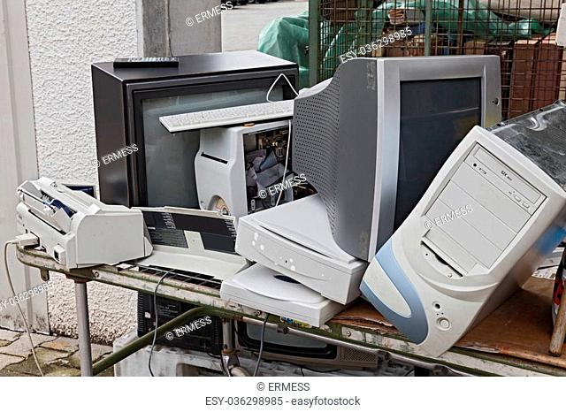 electronic waste: old computers, monitors, televisions and other devices to recycle
