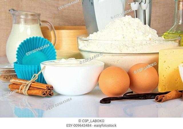 Eggs, sour cream, spices, flour, cheese, cake pan