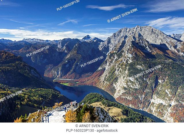 Tourists looking over lake Königssee and the Watzmann massif from belvedere on the mountain Jenner in autumn, Berchtesgaden National Park, Bavarian Alps