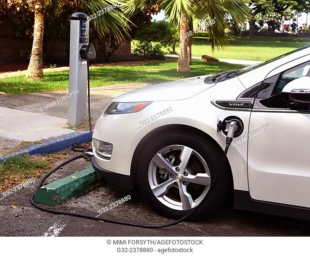 Recharging electric car, Hawai'i, USA