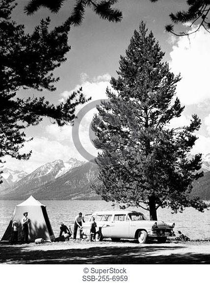 Men and women with their children at the lakeside, Jackson Lake, Grand Teton National Park, Wyoming, USA
