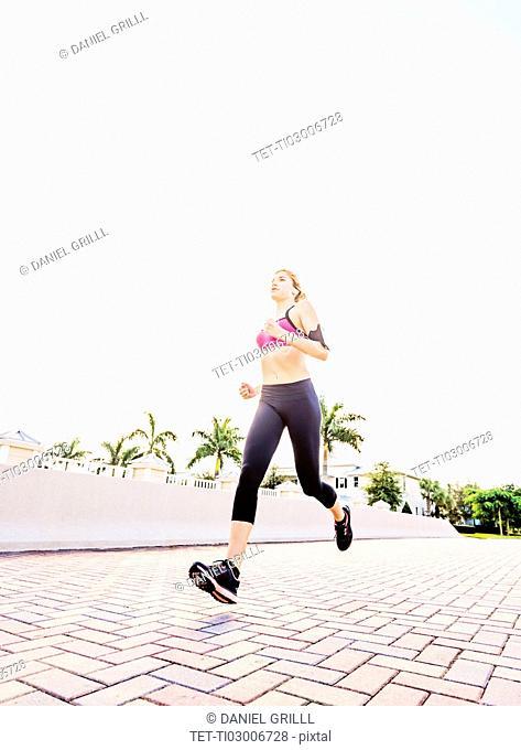 Woman running along promenade