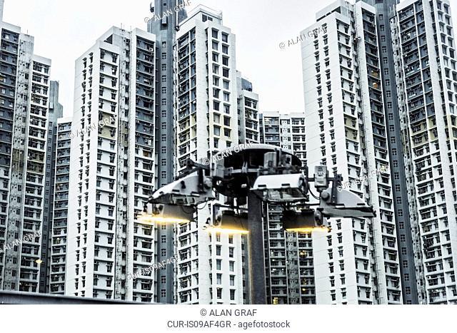 Floodlight and apartment blocks, Hong Kong, China