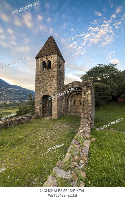 Pink clouds at sunset on the old Abbey of San Pietro in Vallate Piagno Sondrio province Lower Valtellina Lombardy Italy Europe