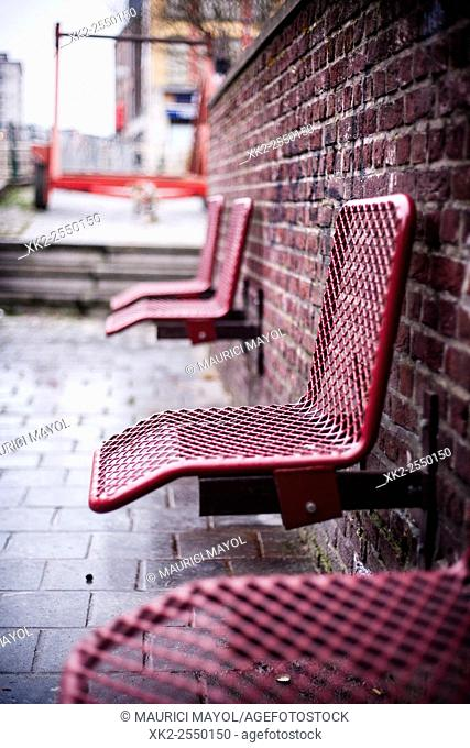 Red seat against the brick wall, Ghent, Belgium