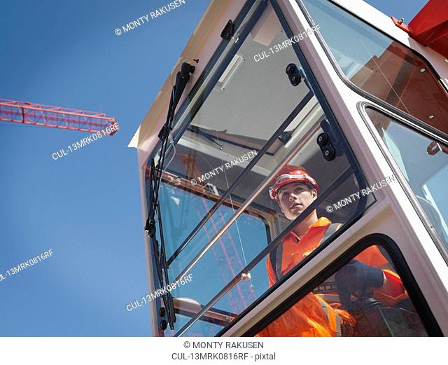 Worker Controlling Crane From Cabin