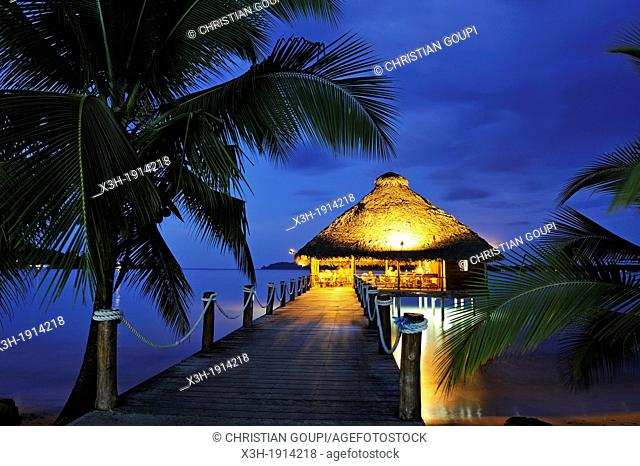 bar and restaurant on stilts at dusk, Playa Tortuga hotel, Colon Island, Bocas del Toro Archipelago, Republic of Panama, Central America