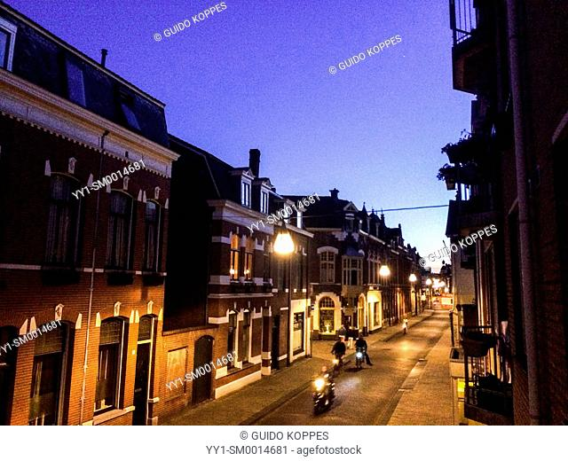 Tilburg, Netherlands. Westbound view of the down town Tuinstraat during sunset