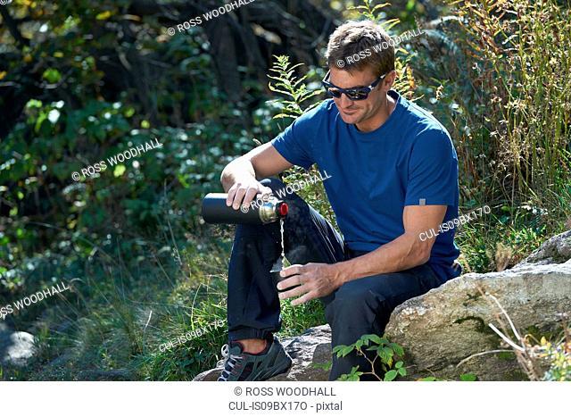 Climber having drink, Chamonix, Rhone-Alps, France