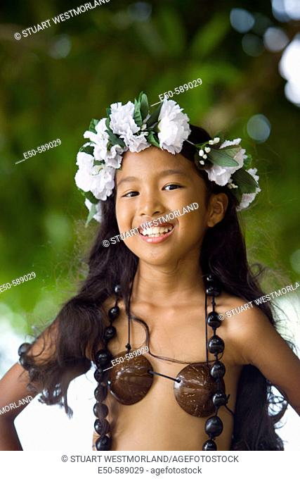 Girl (age 9) in Poynesian. Dance Outfit, Palau, Micronesia, Rock Islands, World Heritage Site, Western Pacific