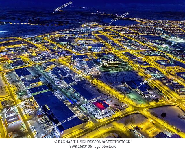 Top view of roads, homes, buildings at twilight, wintertime, Reykjavik, Iceland. This image is shot with a drone