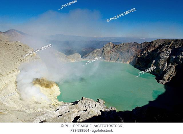 Mining Sulfur by Hand in Kawah Ijen Volcano around 2500m alt. Men working inside Kawah Ijen volcano, in East Java, one of the last places in the world where...