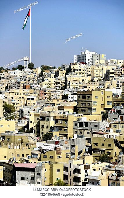 Panoramic view of Amman, Jordan and the National flag