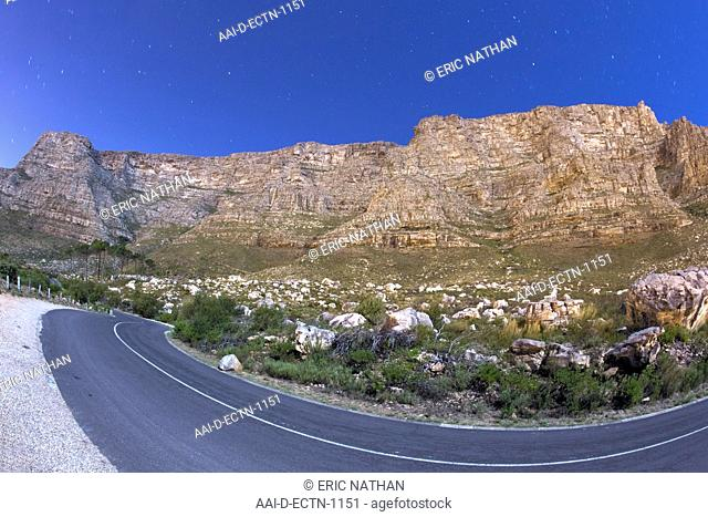 Table Mountain from Tafelberg Road at night under full moon. Cape Town, South Africa