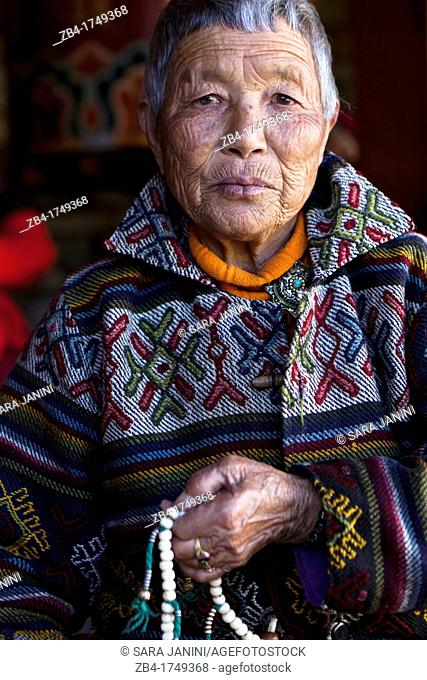 Portrait of a bhutanese old woman at the Memorial Chorten, Thimphu, Bhutan, Asia
