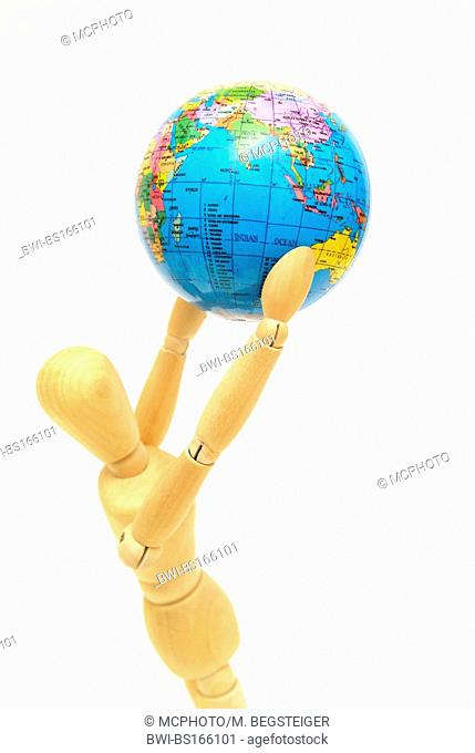 jointed doll with globe in hands