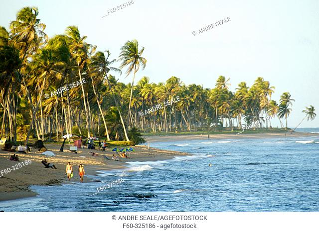Tourists relax at Forte's beach. Bahia, Brazil