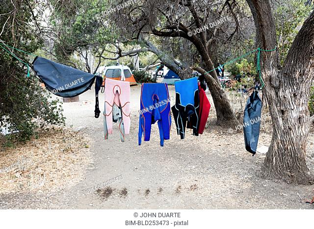 Wet clothing hanging on clothesline near camping tent