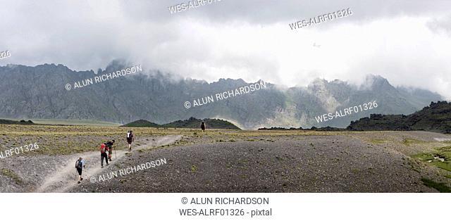 Russia, Caucasus, Mountaineers hiking in Upper Baksan Valley