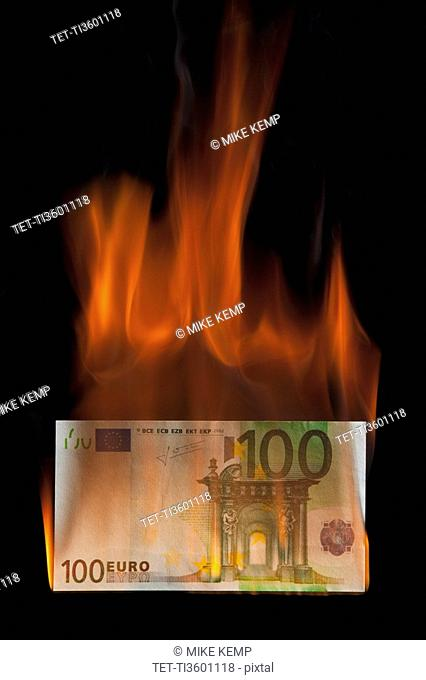 Burning 100 euro bill