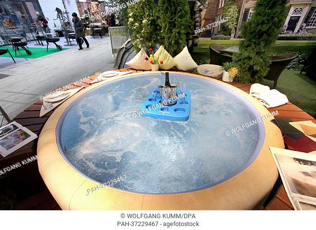 An outdoor jacuzzi is set up at the 'Gartentraeume'gardening fair inBerlin,Germany, 15 February 2013. This year's motto is 'Sustainable gardening'
