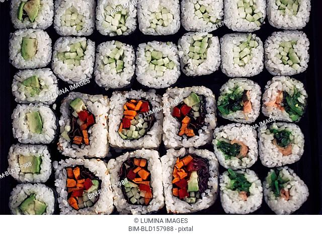 Close up of tray of sushi rolls