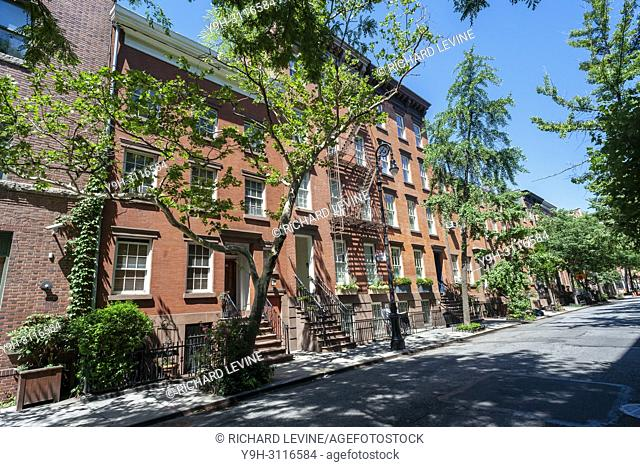 A block of West Village attached townhouses and small apartment buildings in New York on Thursday, July 5, 2018. (© Richard B, Levine)