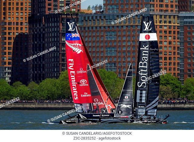 America's Cup World Series New York - SoftBank Team Japan and Emirates Team for New Zealand race on the Hudson River by the Lower Manhattan skyline during the...